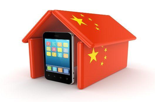 Modern mobile phone under chinese flag.